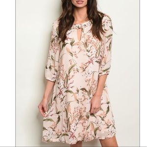 Pale peach scoop neck lily floral tunic dress.